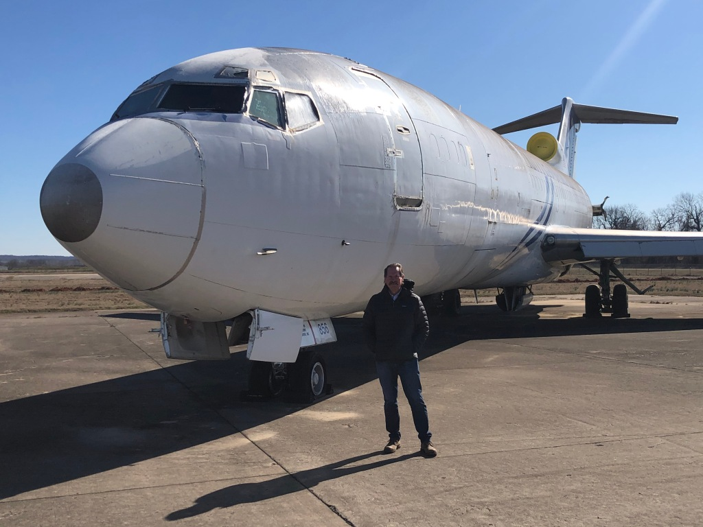 ATS World Wide LLC CEO/VP Vince Howie poses before a Boeing 727 that will be used for prototype testing.