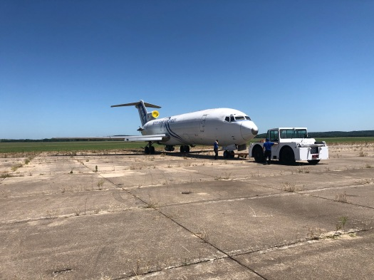 Aircraft Towing Systems World Wide LLC recently moved its 727 jet into place for the testing of its new prototype aircraft transport system.